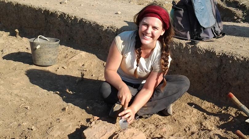 Genevieve Mifflin '14 fits together ancient mud bricks in her excavation area at Zincirli Höyök. (Photo by Jason Herrmann)