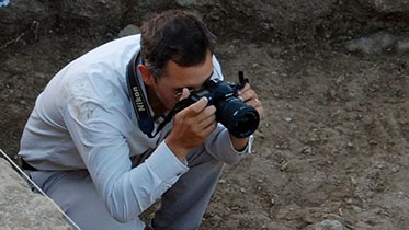 At the site of Zincirli Höyük in Turkey, Jason Herrmann documents the excavations. (Courtesy of Jason Herrmann)