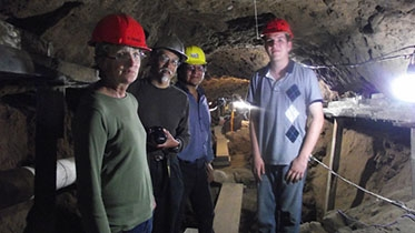 Andres Mejia-Ramon '16, with Dartmouth professors Deborah Nichols and John Watanabe; and Peruvian archaeologist Adán Umire Alvarez, explores a tunnel beneath the Pyramid of the Feathered Serpent at Teotihuacan.