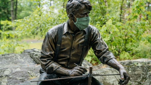 Robert Frost Statue on Dartmouth Campus with Mask