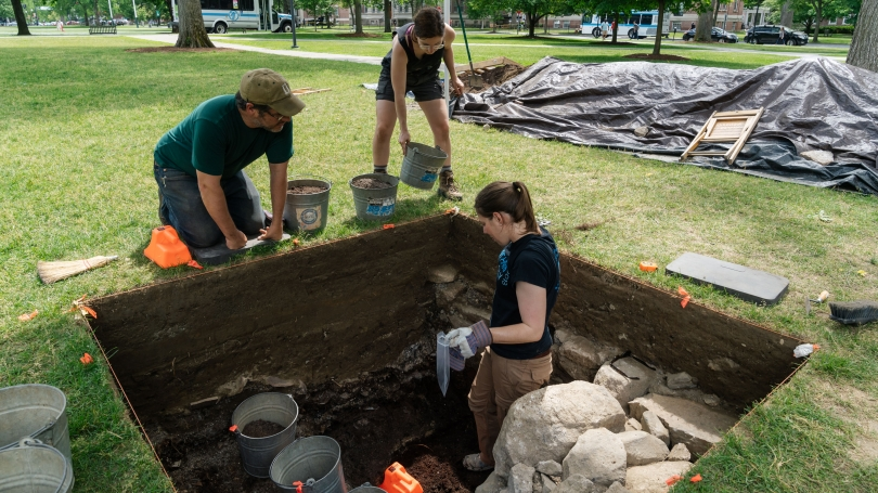 Professor Jesse Casana and students excavate an old privy.